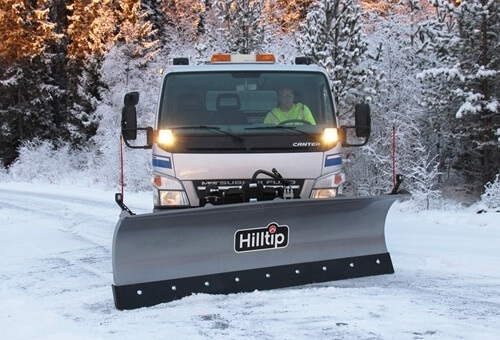 Truck with straight snowplow